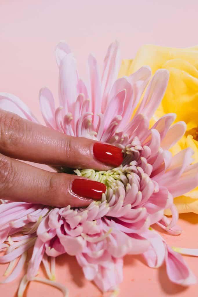 woman sensually touching a flower