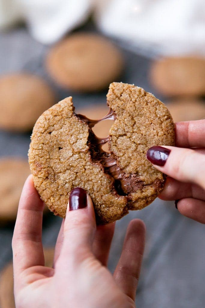 A thick and chewy gingersnap cookie with a gooey Nutella center.