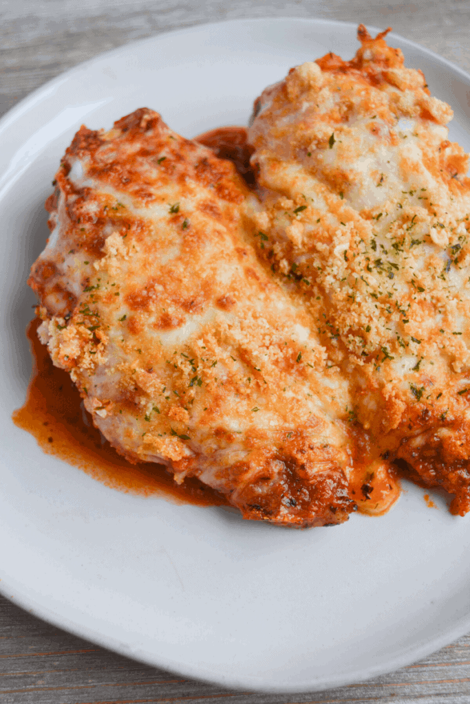 air fryer chicken parmesan on a white plate