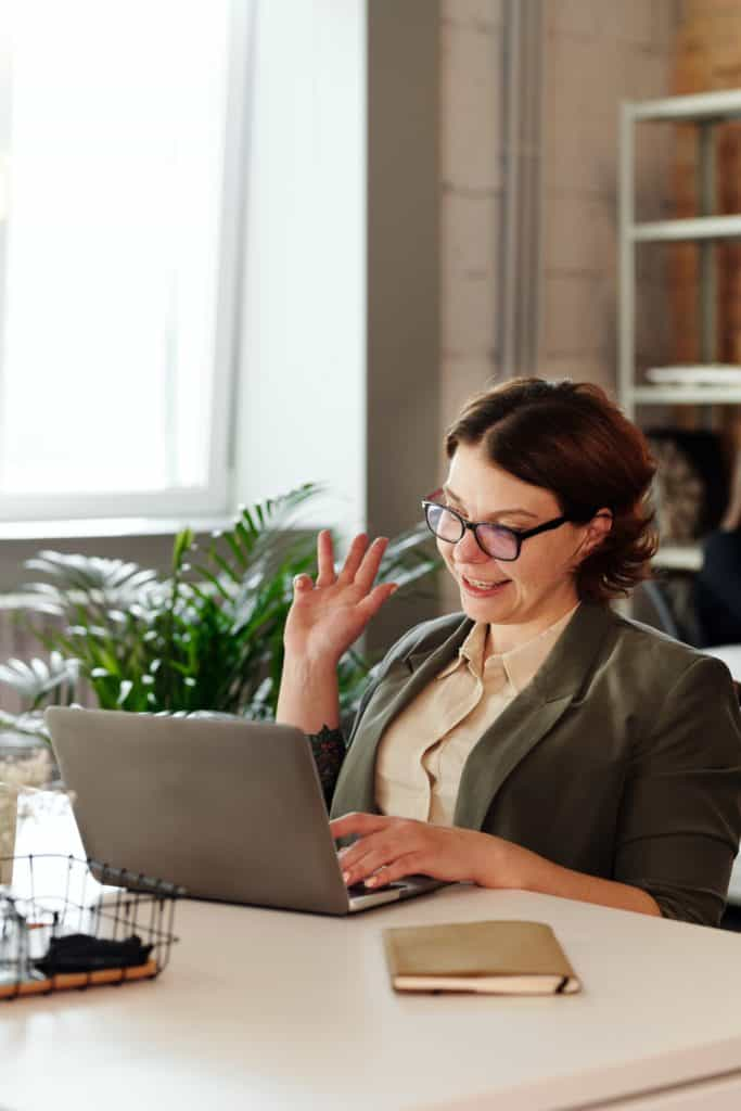 woman remote worker on laptop on video call