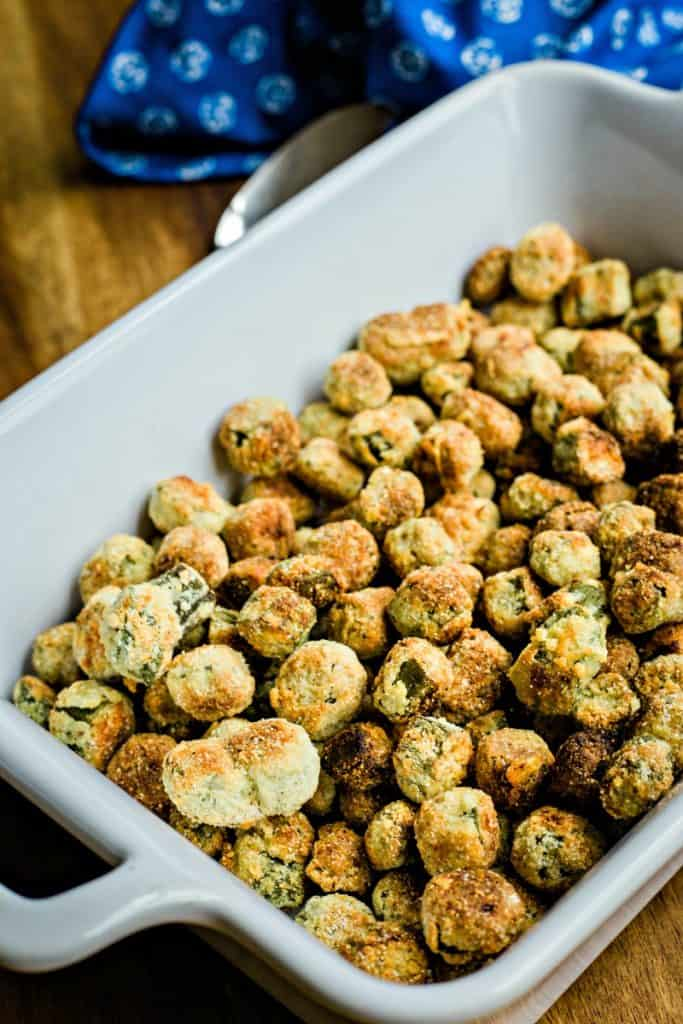 oven fried okra in a white baking dish