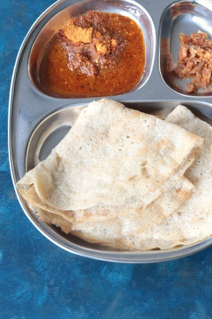 Oats Dosa served with podi and vellam (jaggery)