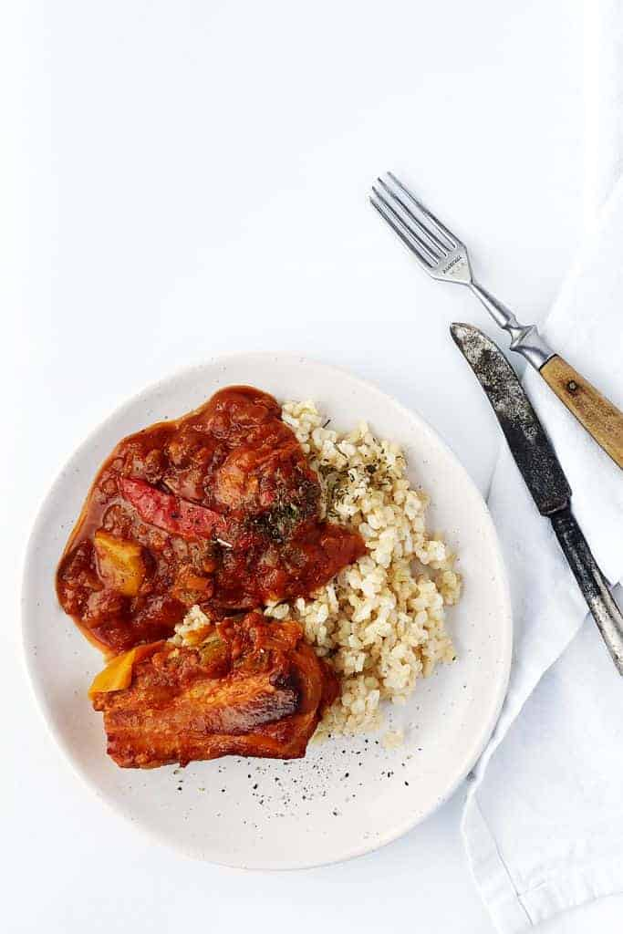 Slow cooked pork belly braised in tomato sauce