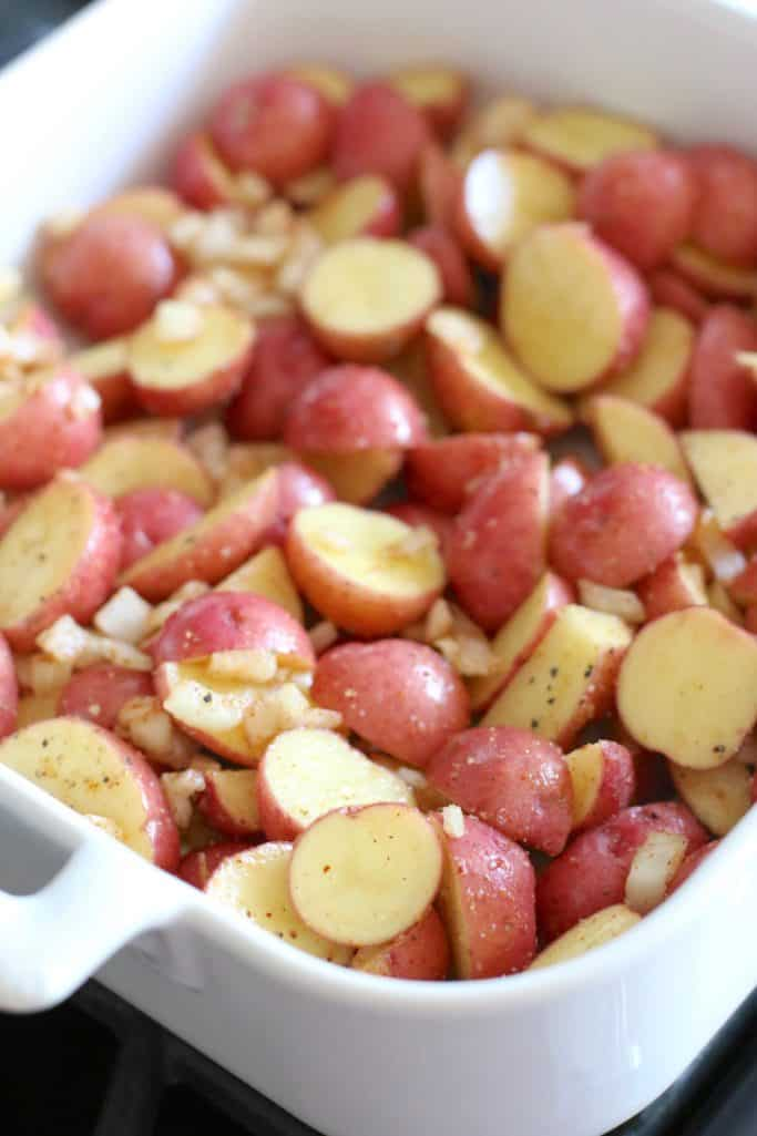 seasoned, sliced baby red Little Potatoes in a white Revol baking dish