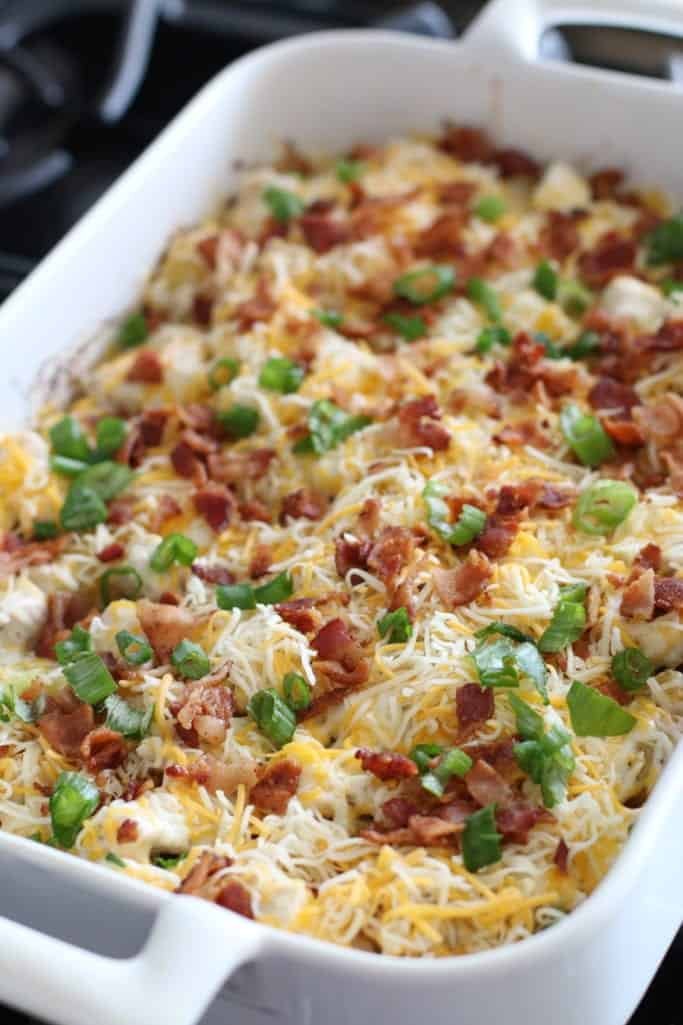 shredded cheese, bacon and green onion with diced potatoes and chicken