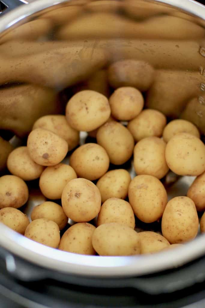 potatoes in bottom of pressure cooker