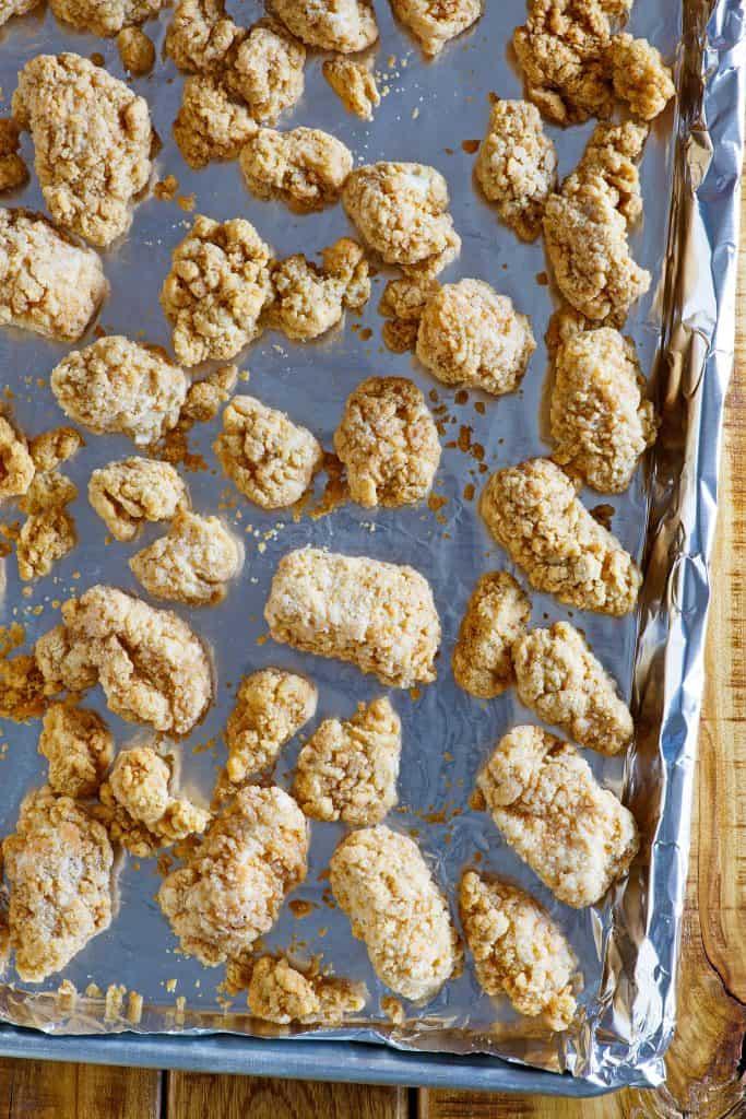 popcorn chicken on baking sheet