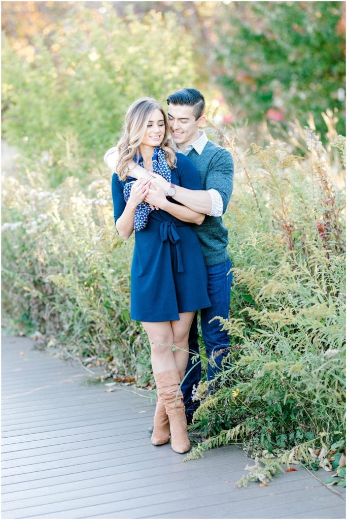 engagement session portrait of a couple hugging and laughing