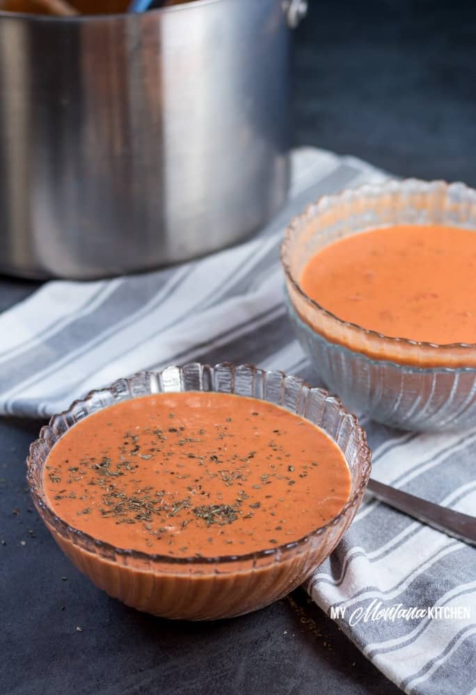 This creamy low carb tomato soup makes an easy dinner idea for families, or makes a great easy lunch! Leftovers can easily be reheated for later, making this a versatile healthy meal idea! #lowcarb #thm #trimhealthymama #tomato #tomatosoup #glutenfree #lowcarbsoup #healthymealidea #easylowcarbrecipe #trimhealthymamasoup