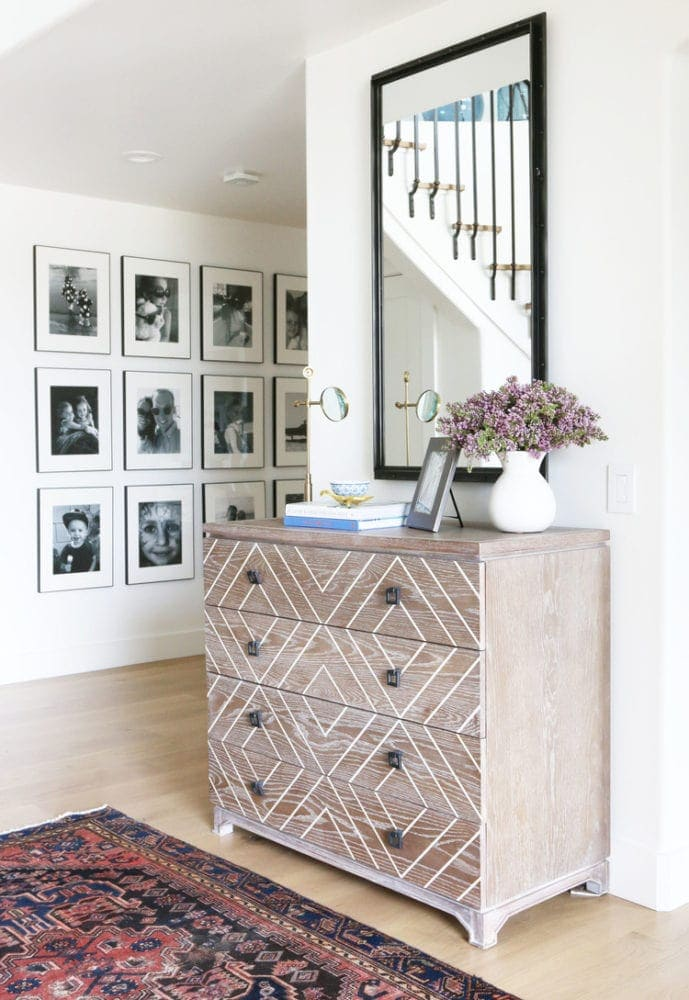 hallway with grid of family photos