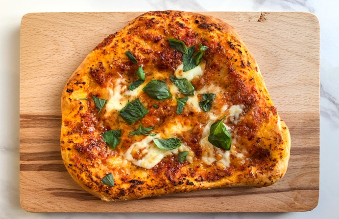 pizza with fresh basil.