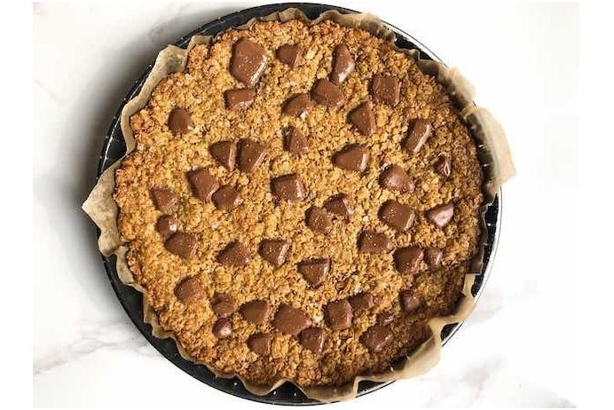 Easy flapjack recipe with shards of chocolate on top by food and travel journalist Melanie May.