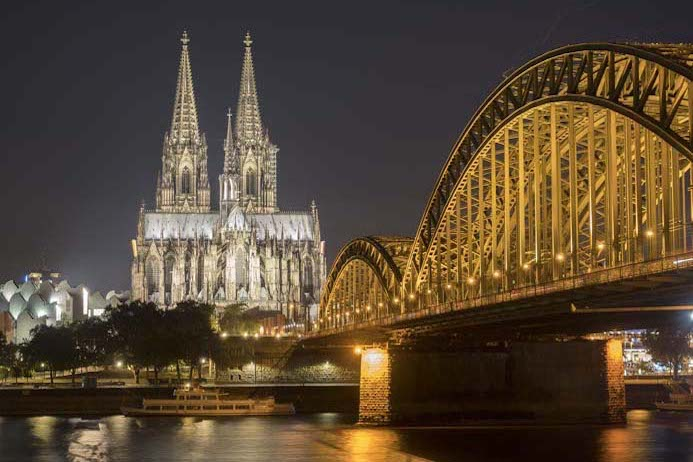 Cologne City Guide photo of Cologne Cathedral at nighttime by the river Rhine