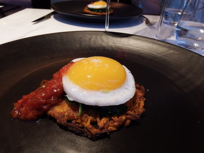 Non-veggies would love this plate of simple, yet elegant fried duck egg, sweet potato rosti wilted spinach and tomato cilantro sauce from the Coburg in the Conrad Hotel in Dublin