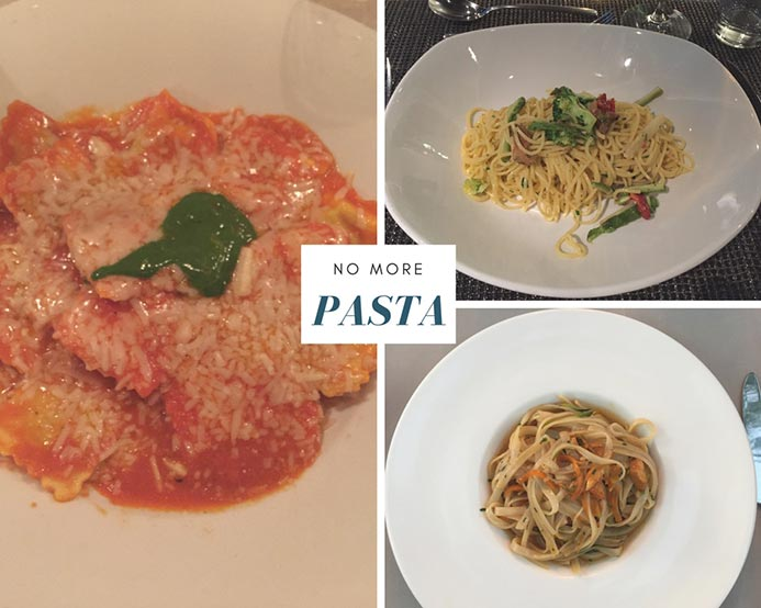 Three dishes of pasta, the default vegetarian option at most restaurants.