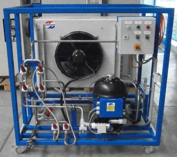Ammonia refrigerant recovery unit showing compressor, control panel and condenser in a frame