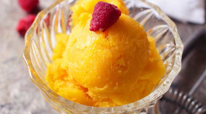 Creamy Mango Sorbet For One made with 1 fresh mango or frozen mango chunks, honey and lemon juice. This single serving dessert recipe can be made in the blender and no ice cream maker needed! | One Dish Kitchen
