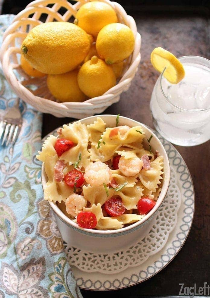 shrimp and prosciutto with pasta in a bowl