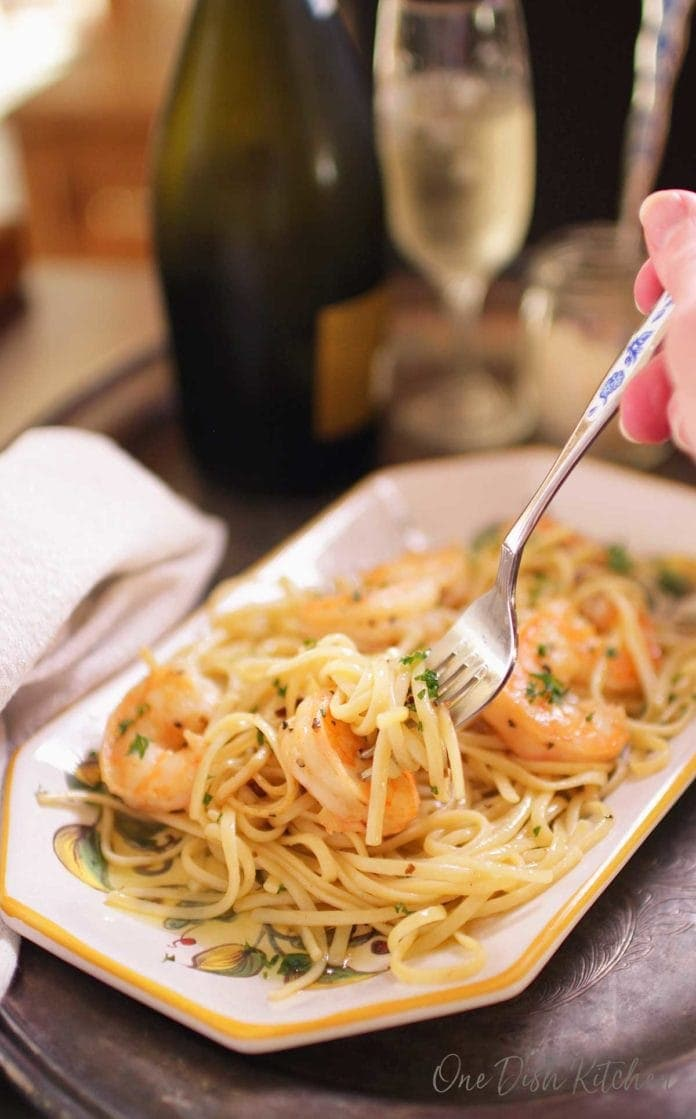 eating shrimp scampi with a fork surrounded by the scampi sauce | one dish kitchen