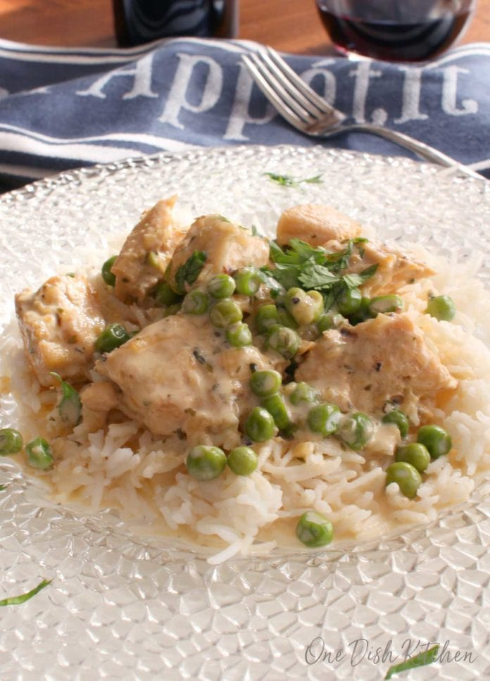 a plate of chicken with creamy sauce and peas | one dish kitchen