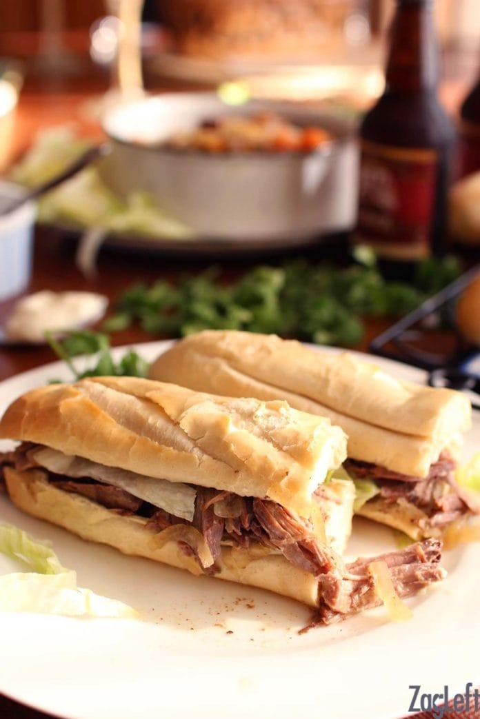 Roast Beef Po-boys - crusty french bread stuffed with juicy, fall-apart tender roast beef that's been slow cooking for hours, topped with lettuce, mayonnaise and lots of gravy. Good and sloppy, just like they make 'em in New Orleans. | www.zagleft.com