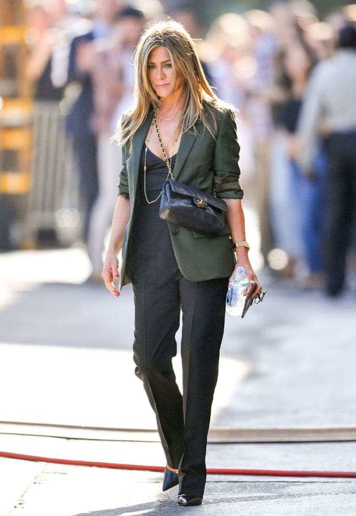 Jennifer Aniston in blazer and bootcut pants | 40plusstyle.com