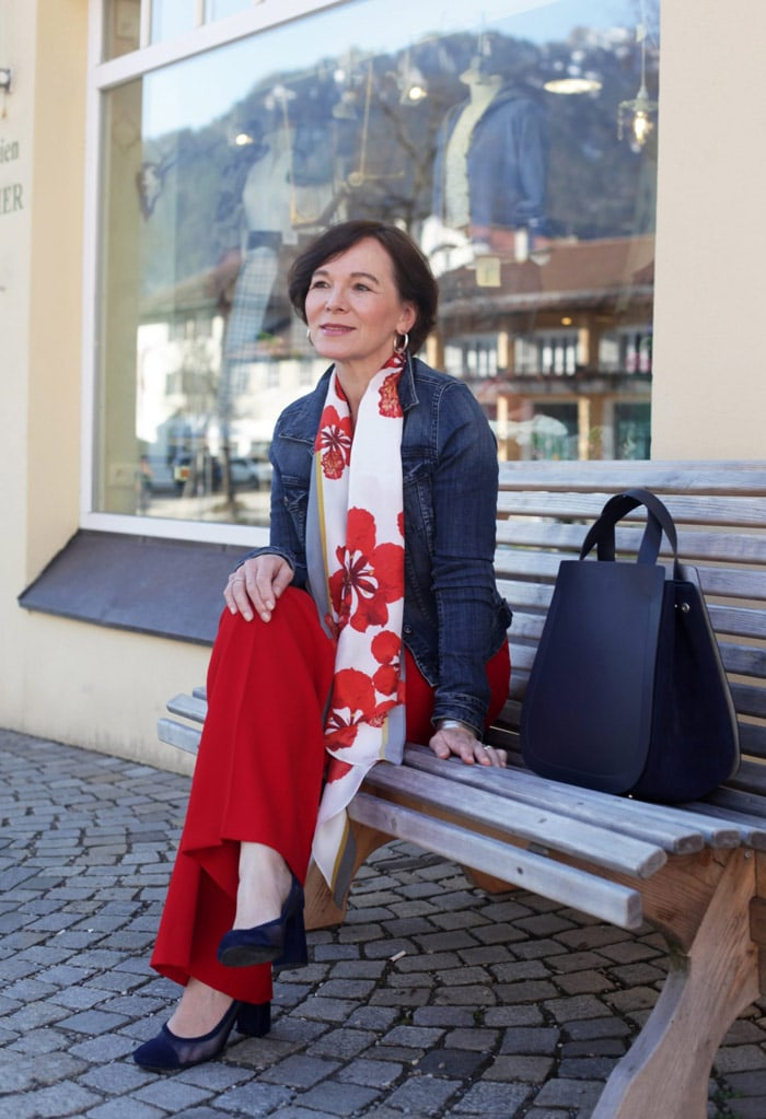 Annette Casual Wearing Denim Jacket with Scarf and Red Pants | 40plusstyle.com