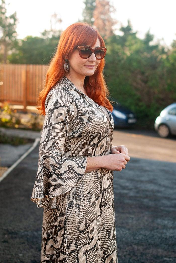 Catherine wearing printed ruffle sleeve dress | 40plusstyle.com