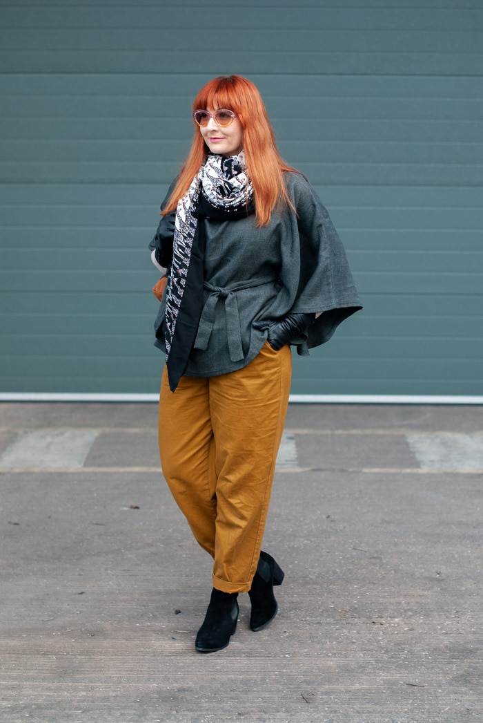 Catherine wearing wrap poncho top, scarf and trouser | 40plusstyle.com