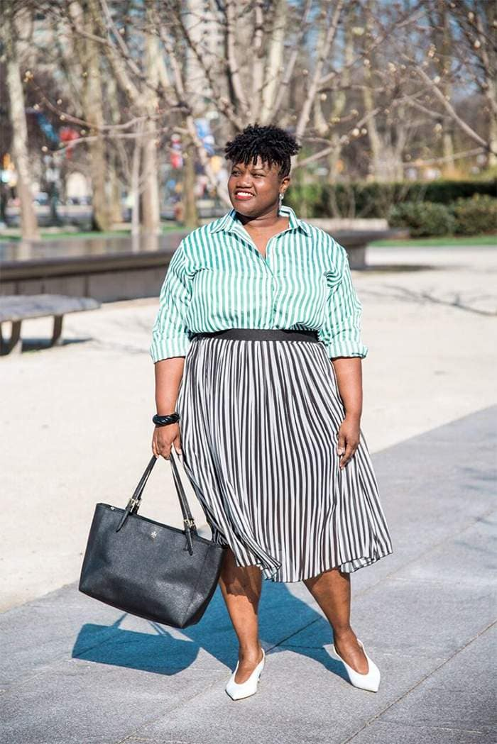 Georgette from Grown and Curvy Women is wearing Green Stripe Blouse and Pleated Skirt and Black Tote | fashion over 40 | 40plusstyle