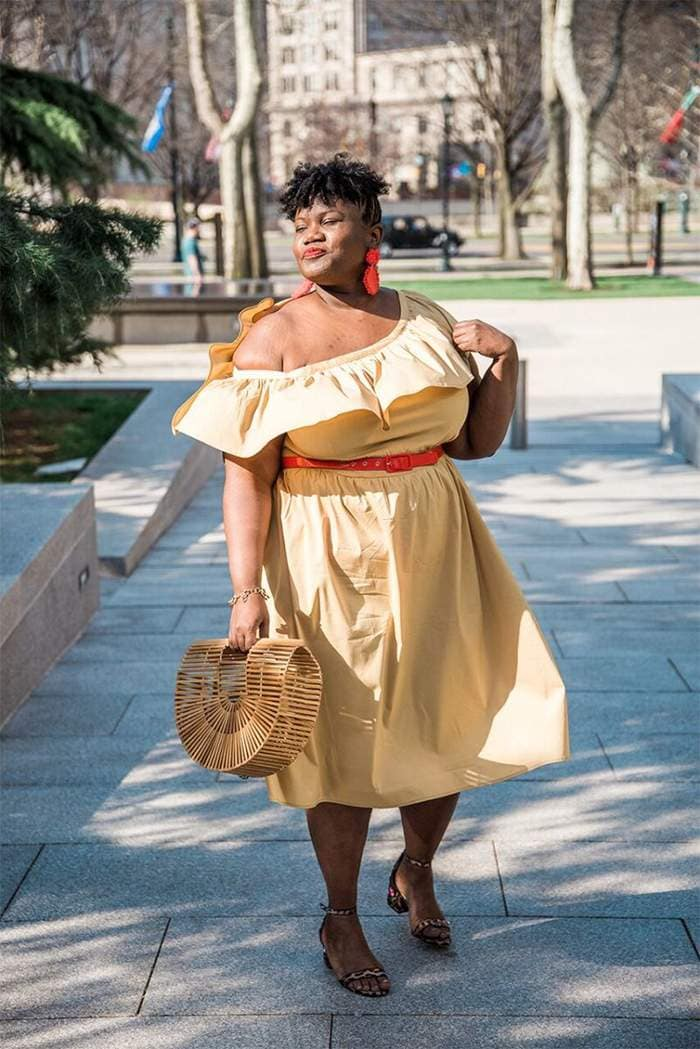 Georgette from Grown and Curvy Women is wearing Off shoulder yellow belted dress with Arc Bamboo bag and Red Earrings | fashion over 40 | 40plusstyle