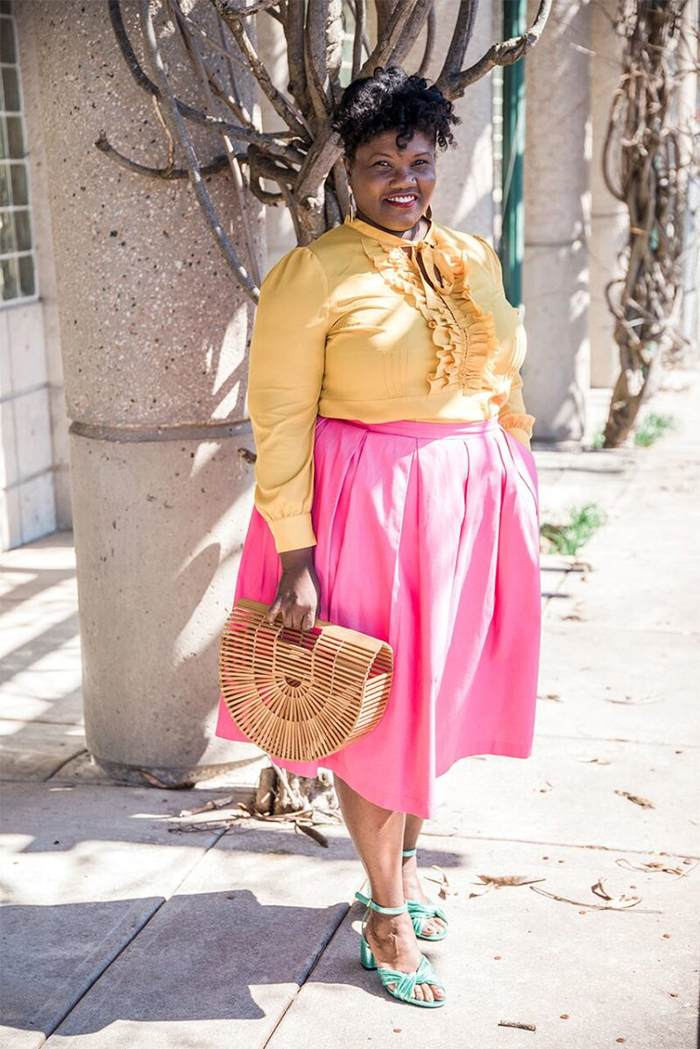 Georgette from Grown and Curvy Women is wearing Yellow Blouse with Pink Skirt and Arc Bamboo bag | fashion over 40 | 40plusstyle