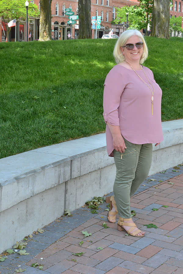 Julia wearing rose pink top with green pants | 40plusstyle.com