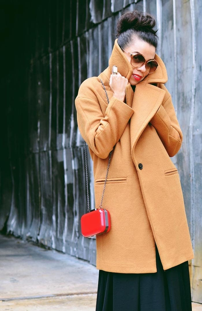Carelia wearing a camel coat | 40plusstyle.com