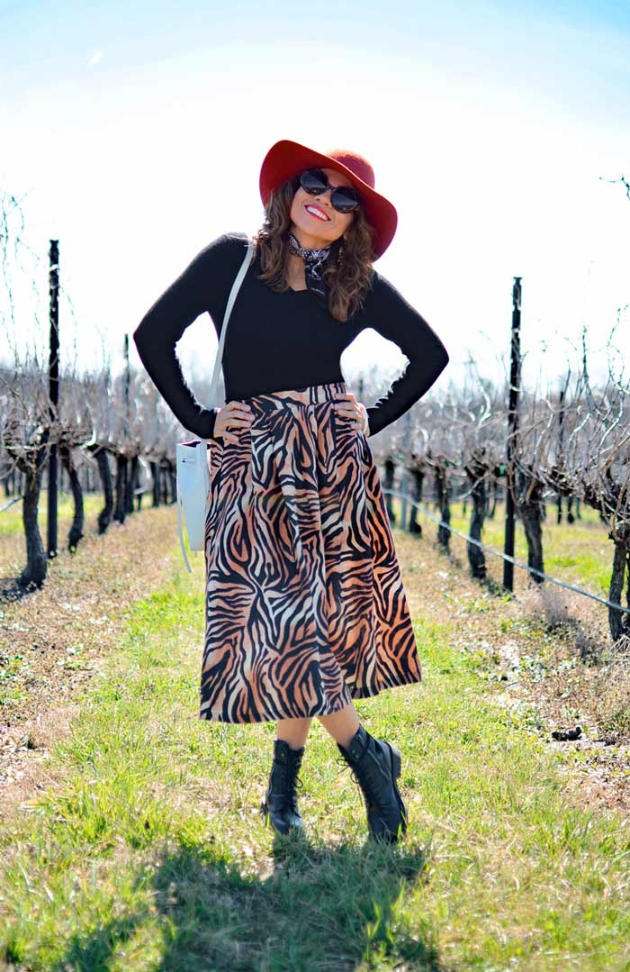 Carelia wearing leopard print skirt and combat boots | 40plusstyle.com