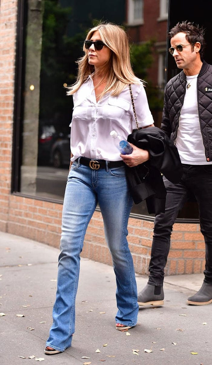 Jennifer Aniston in button down shirt and bootcut jeans | 40plusstyle.com