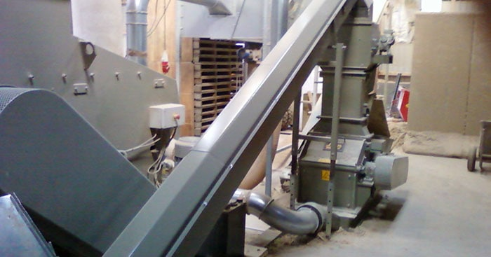 wood shredded and re shredder connected with augers/screw conveyors with a helical screw blade are used as a chip transport discharge system for woodworking scrap