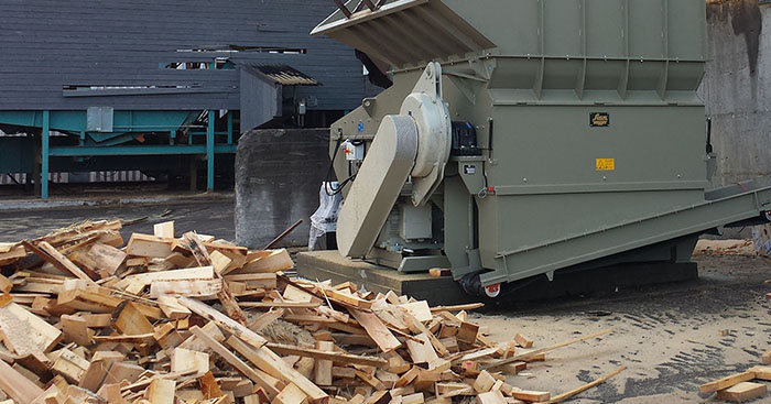 Scanhugger wood waste recycling shredder at production plant shredding offcut wood outside