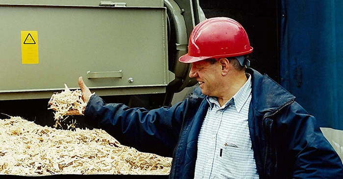 Man happy for his biomass recycled wood after it was shredded