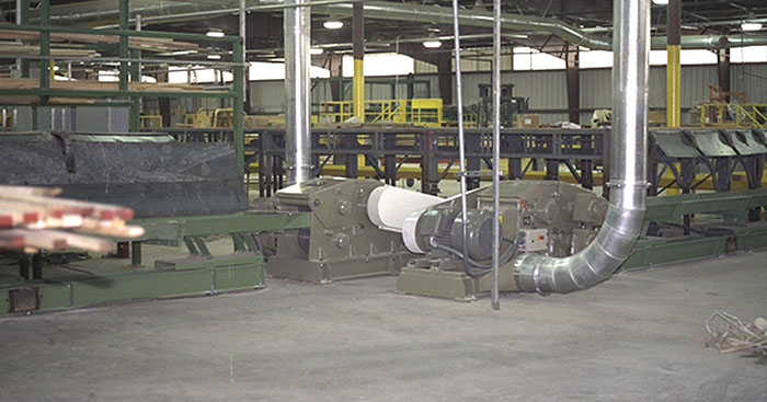 two wood chippers at sawmill factory working inline with the production line