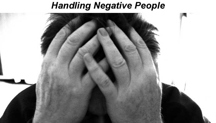 Handling negative people (man with his head in his hands)