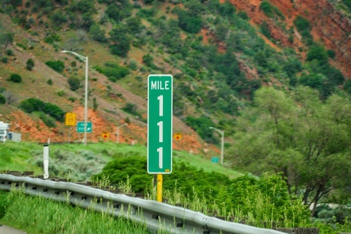 mile 111 sign