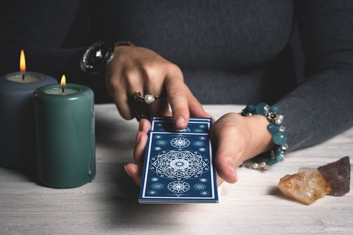 person pulling tarot cards