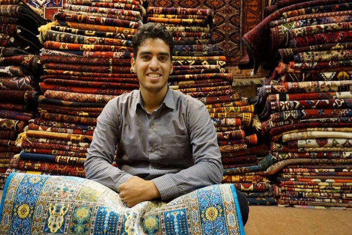 Ali, a carpet seller in the Bazaar, Isfahan, Iran – Experiencing the Globe