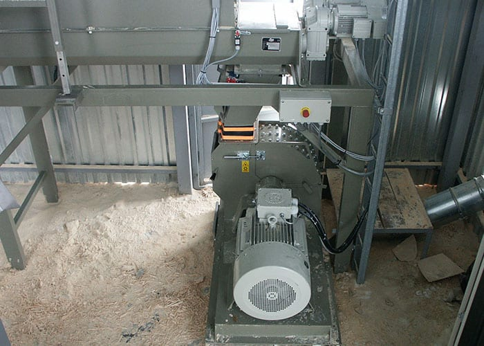 Hammermill installed at costumer with buffer silo feeding shredded wood material.