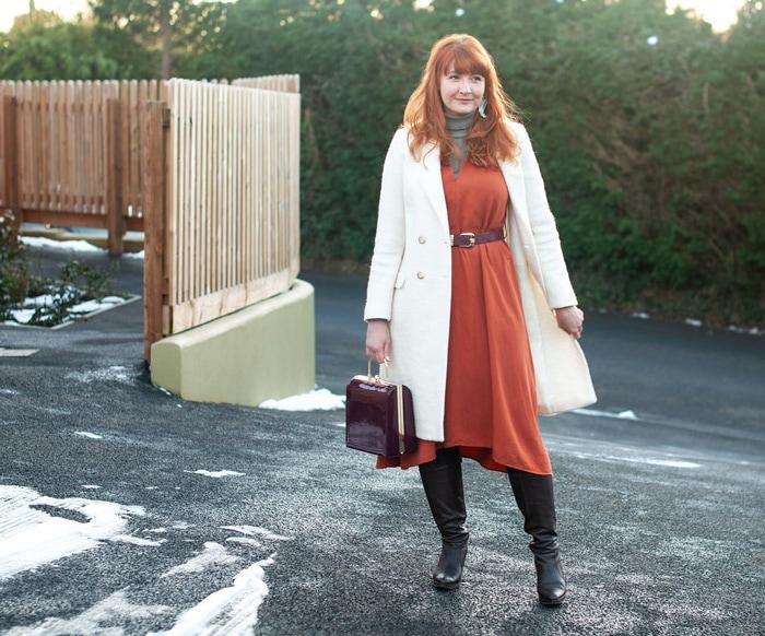 Catherine wearing long white coat | 40plusstyle.com