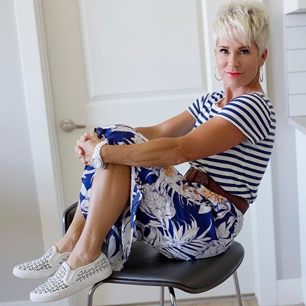 Shauna wearing striped top and floral skirt | 40plusstyle.com