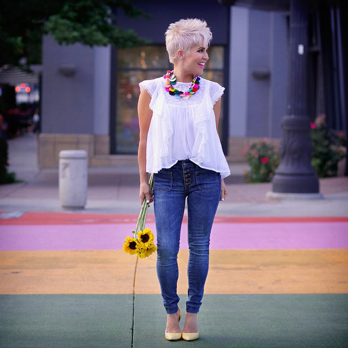 Shauna wearing white flounce top and jeans | 40plusstyle.com