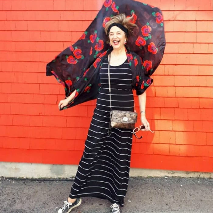Terri wearing a striped maxi dress and floral cardigan | 40plusstyle.com