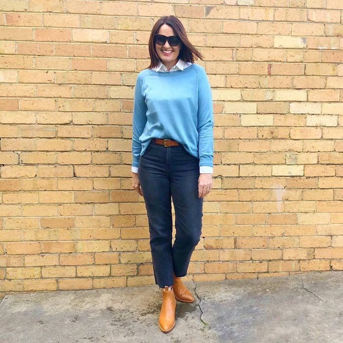 Layering a shirt and sweater worn with jeans and booties | 40plusstyle.com